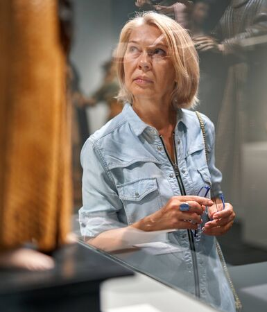 woman visitor looking art object in art gallery museum