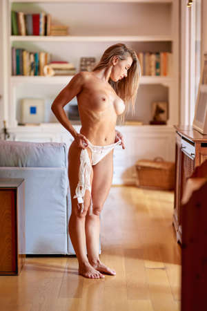 Sexy fit woman with healthy clean skin at home. Beautiful perfect female body of pretty caucasian girl.