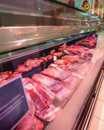 Shop of meat products. Wide selection of meat products in supermarket. Fresh meat in shop window. Pieces of meat in store. Pork, beef on sale Standard-Bild