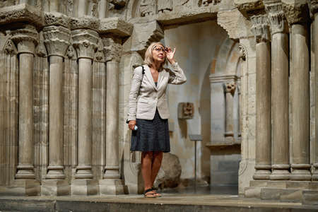 Woman exploring medieval expositions in museum Banque d'images