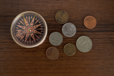 Compass and coins. Table traveler. Background.