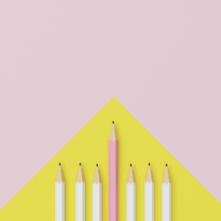 Pink pencil and white pencil on yellow and pink background. minimal creative concept. Stock Photo