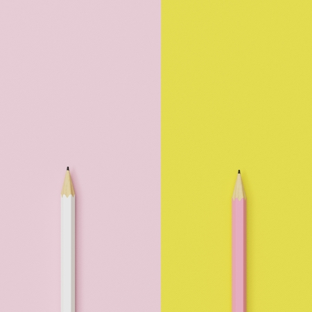 minimal: Pink and yellow pencils on pastel pink and yellow contrast background. minimal creative concept.