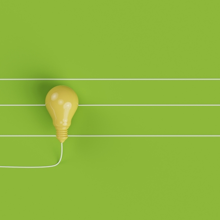 Yellow Lightbulb line on pastel green background for copy space. top view. minimal concept.