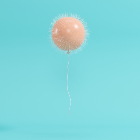 outstanding orange thorn balloon concept on blue background for copyspace. minimal concept.