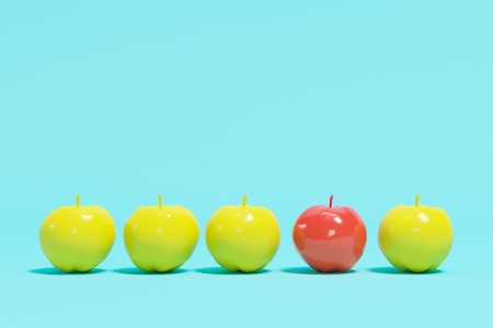 inspiring: Outstanding red apple contrast yellow appples on blue pastel background. minimal concept.
