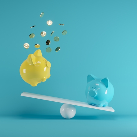 Blue and Yellow piggys bank playing with gold coin on seesaw on blue background. minimal idea funny concept. 版權商用圖片