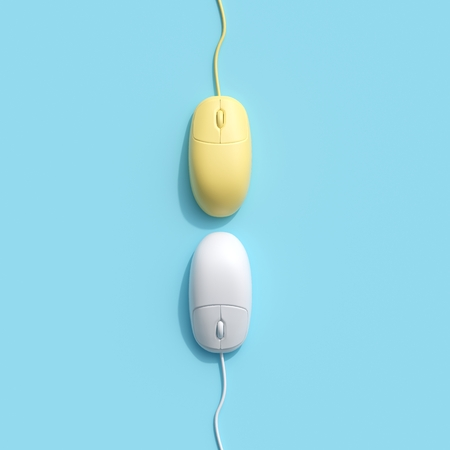 Yellow and White Computer mouse on blue background. top view, flat lay minimal concept. 스톡 콘텐츠