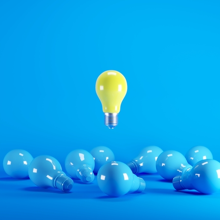 Yellow Lightbulb floating among blue lightbulb on background. minimal idea concept.