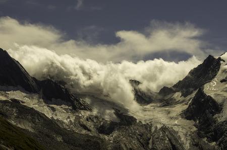 embedding: clouds in the mountains Stock Photo