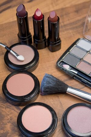 Various make-up objects on a wooden base