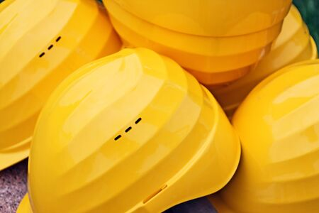 Yellow safety helmets on a construction site Imagens