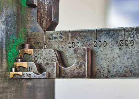Detail of an old measuring instrument with scale on a village square in Germany Standard-Bild