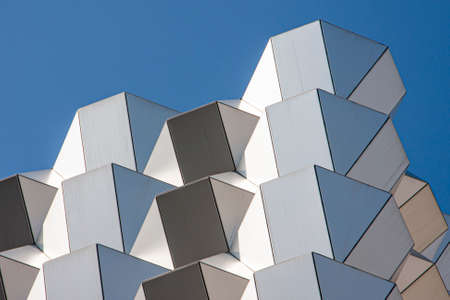 Modern facade elements in geometric shapes and blue sky for a background structure