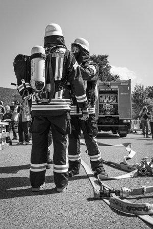 Neckargemuend, Germany - May 1, 2019: Open day, volunteer fire brigade Neckargemuend, Germany. Fire fighters showing their skills Editorial
