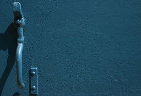 old blue metal door with opening mechanism