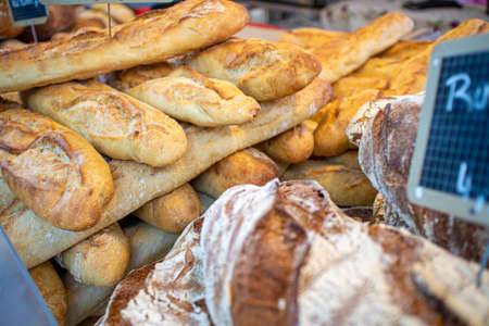 Baguette and other breads exhibited at a gourmet market with French products Standard-Bild