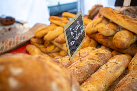 Neckargemuend, Germany: September 6, 2019: Baguette and other breads exhibited at a gourmet market with French products Editorial