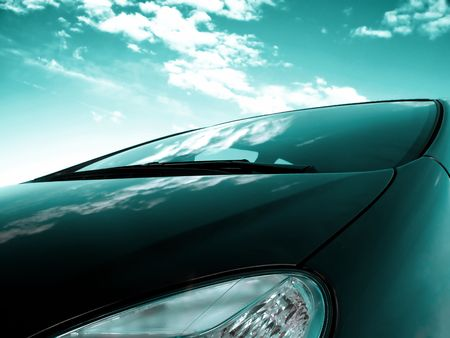 close up of a frontside of a car under a cloudy blue sky Stock Photo - 3573263