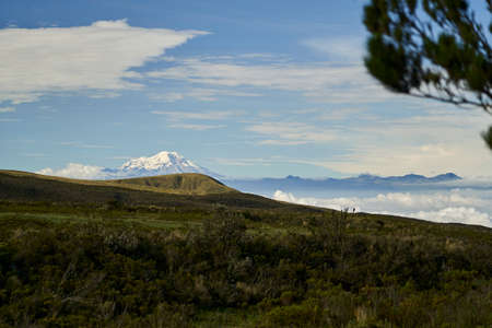 View to the Illinois, a pair of volcanic mountains that are located to the south of Quito, Ecuador, seen from the foot of Cotopaxi volcano