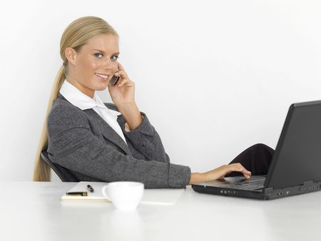 Young, fresh female businesswoman with computer photo