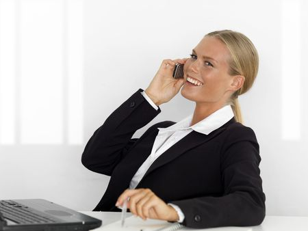 businees: Fresh, young businesswoman in office situation