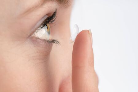 A close-up of a woman who wants to use a contact lens