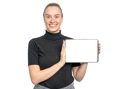 a woman holds a tablet with blank surface in the camera