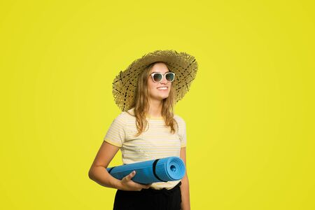 young woman with a yoga mat under the arm Stock Photo
