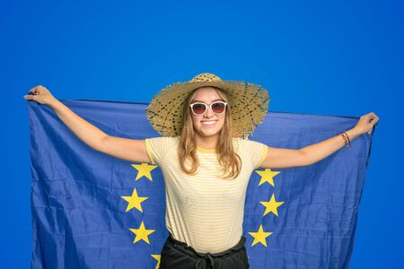 young woman with a European flag symbolized together