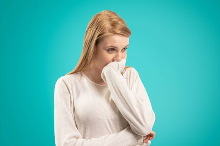 thoughtful woman who supports her chin with her hand Stock Photo