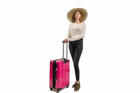 woman with suitcase and summer hat against a white background Stock Photo