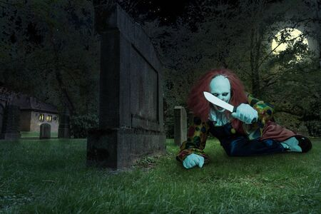 a scary clown with a knife on a cemetry