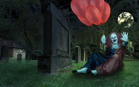 scary clown with ballons in his hand on a cemetry