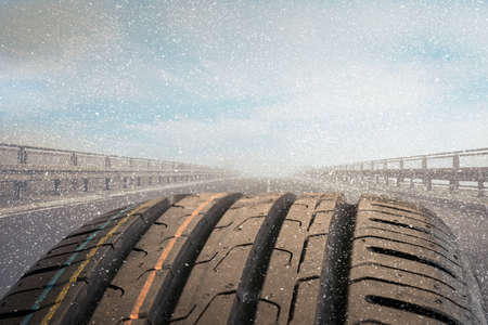 a detail photo of a car tire on a road