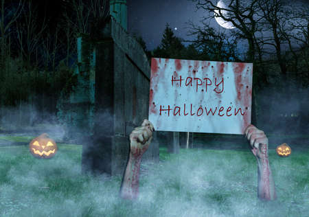 tow hands sticking out of the ground in a cemetery with a Happy Halloween sign
