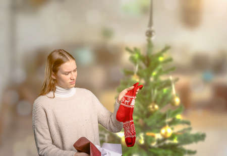 a young woman is unhappy about her Christmas gift