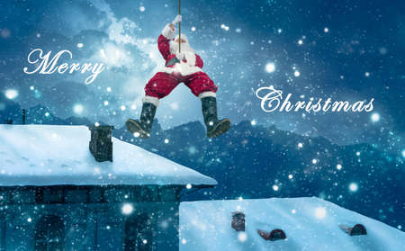 christmas greeting card of santa's arrival by lowering himself onto a roof on a rope