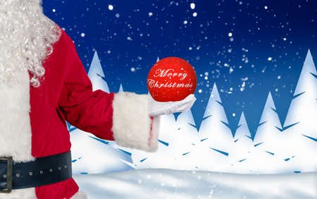 santa holds a glass ball with Christmas wishes in his hand against wintery background