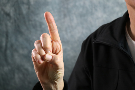 American Sign Language (ASL) letter D held in correct position next to body Stock Photo
