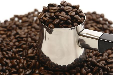 falling out:                     Beans of coffee, falling out of coffee-pot on the white back ground.
