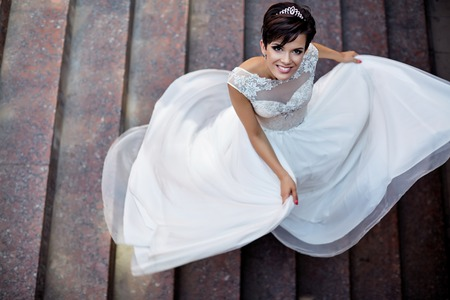 weightless: Wedding. Feeling weightless. Cheerful young bride on the happiest day of her life Stock Photo