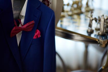 handkerchief: Blue suit with tie and handkerchief. Focused on handkerchief. Stock Photo