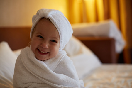 child bath: Child washing in bubble bath . Stock Photo