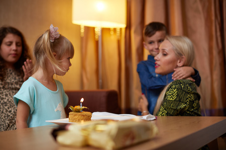 forties: Family Celebrating Childrens Birthday With Grandmother