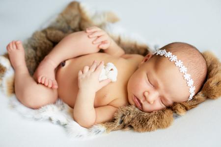 Newborn baby girl sleeping. Stock Photo