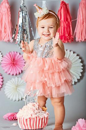 baby girl first birthday cake smash photo shoot stock photo picture