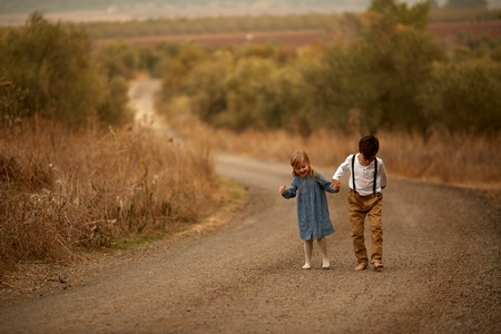 Brother and sister Autumn road