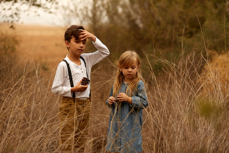 Little girl and boy outdoors