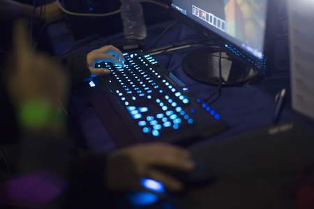 young boy hands on gaming keyboard. late night gamer